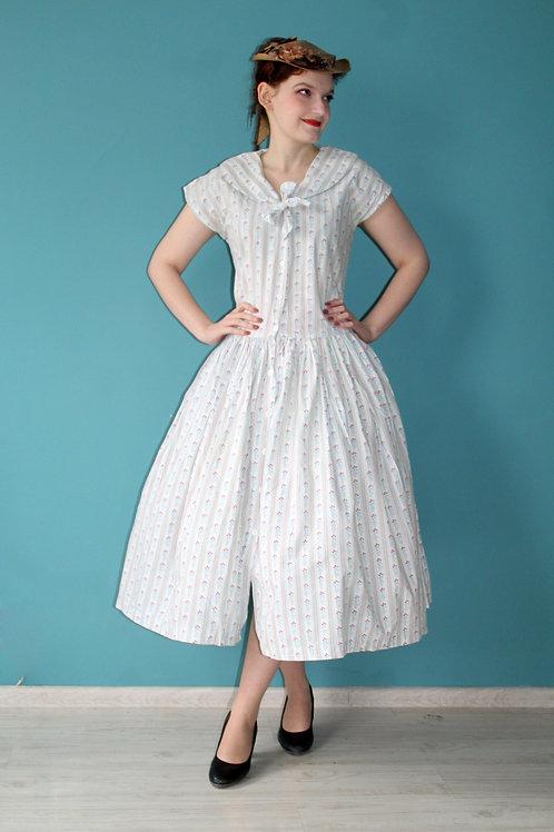 Lata pięćdziesiąte - bawełniana rozkloszowana sukienka w kwiaty bawełna