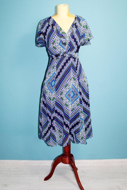 Modern retro jak lata siedemdziesiąte wzorzysta sukienka midi hippisowska