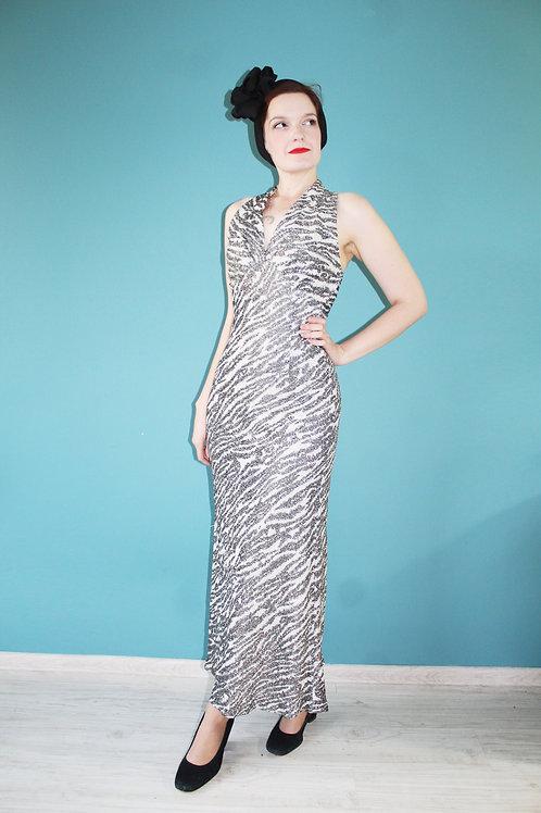 Lata siedemdziesiąte - sukienka maxi w zebrę w stylu disco lureks