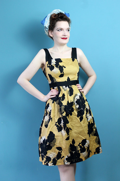 Modern retro w stylu lat pięćdziesiątych musztardowa sukienka w kwiaty