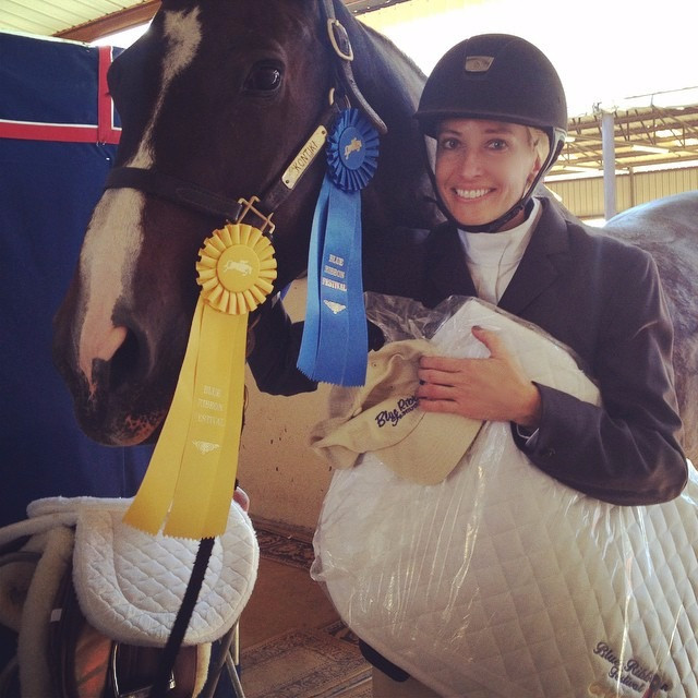 Courtney and her beautiful Warmblood Hunter Benny after a successful show day