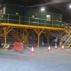 Metal walkway and enclosed space in an industrial building.JPG
