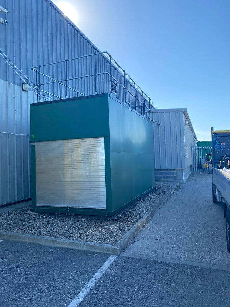 Green metal storage container with railings around the top.jpg