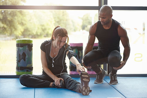 Woman stretching watched by trainer.jpg