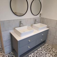 Matching sinks in a renovated bathroom.jpg