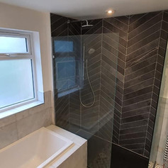 A newly fitted shower and bath.jpg