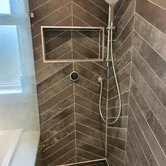 An elegantly tiled shower enclosure.jpg