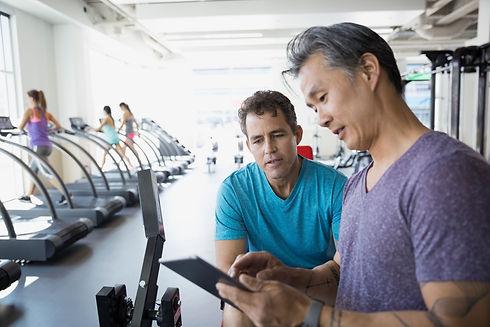 Two men talking in the gym.jpg