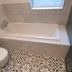 A refurbished bathroom with beautiful tiling.jpg