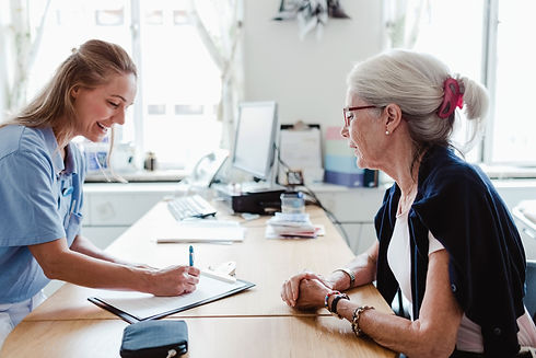 Older woman speaking to a nurse.jpg