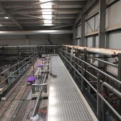 Long metal walkway in an industrial building.jpg