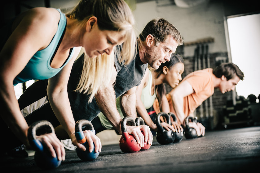 Two men and two women working out.jpg