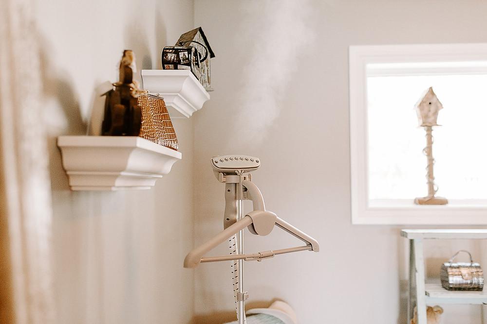 garment steamer blowing steam