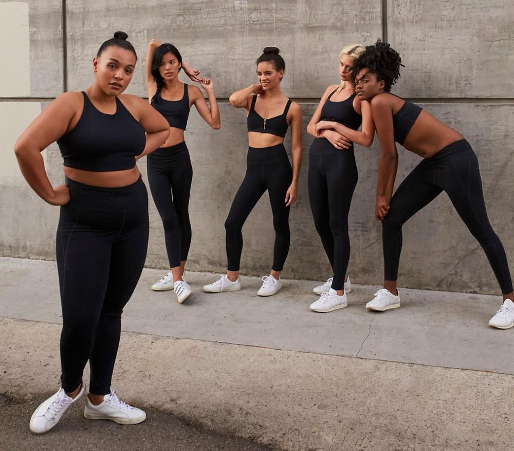 five women posing in girlfriend collective leggings
