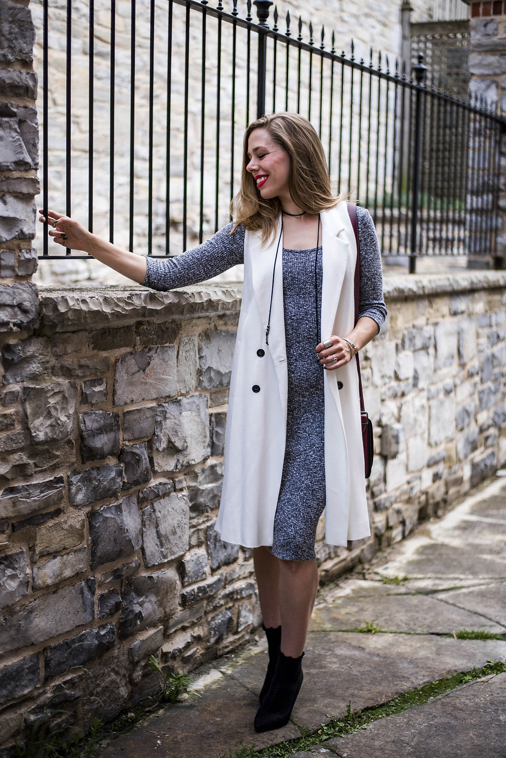 sweater dress and white longline vest