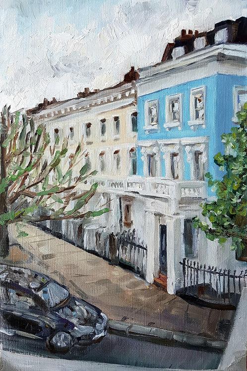 Blue Stucco Terrace House At Dusk