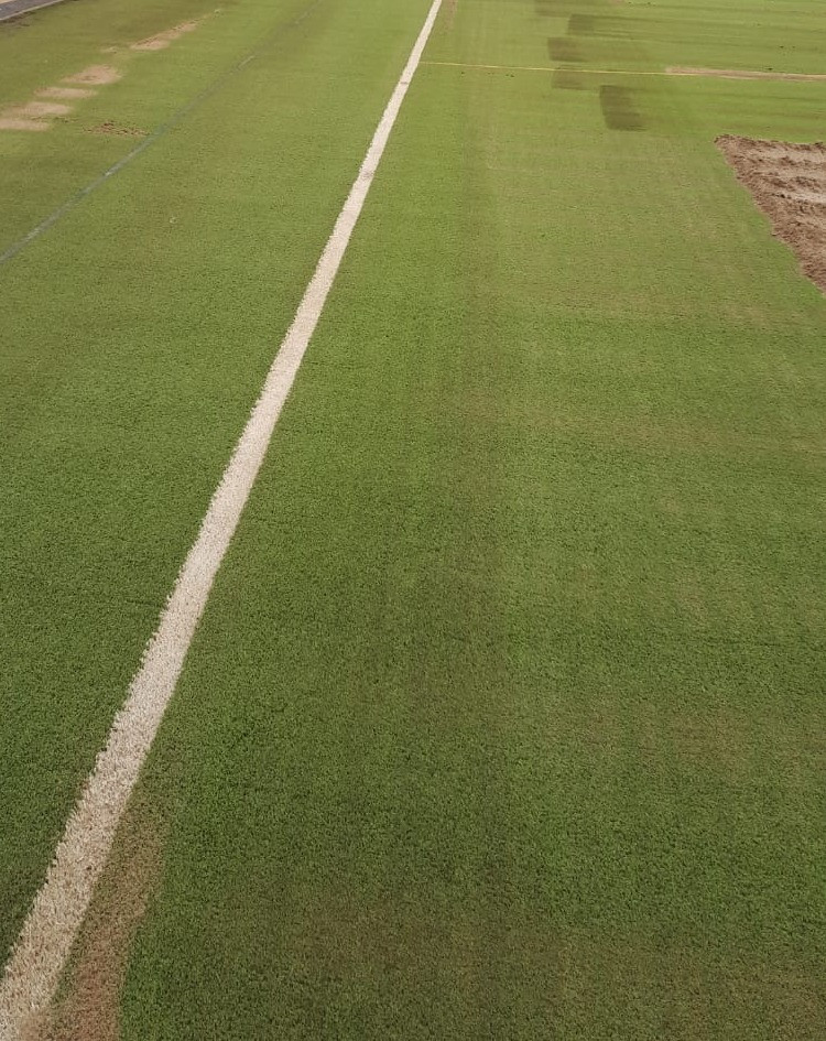 Rejuvenation of Synthetic Grass Pitch Nearing the end of the process with infill being applied back into the surface
