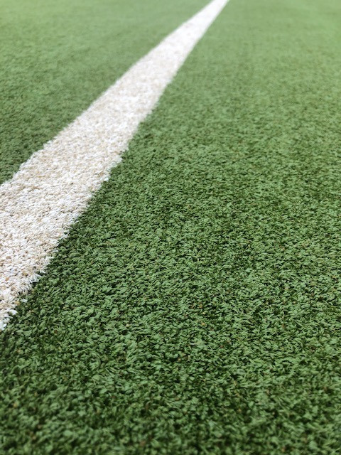 Close Up of Synthetic Grass Fibres after Maintenance Service