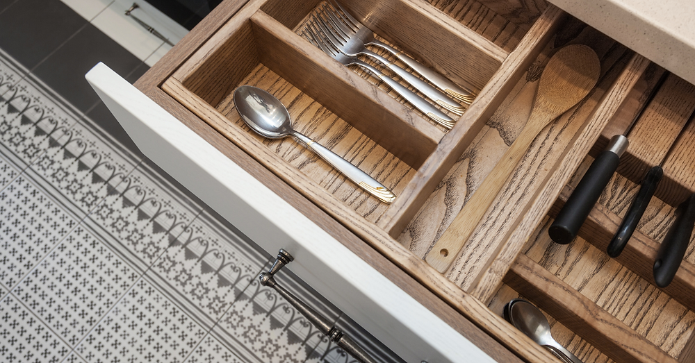 organized kitchen drawer with forks spoon and knives
