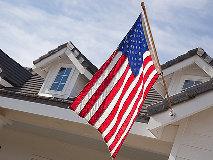 The exterior of a residential house with an American Flag displayed