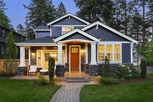 Exterior Blue House at Dusk - Security First Financial Colorado Home Loans