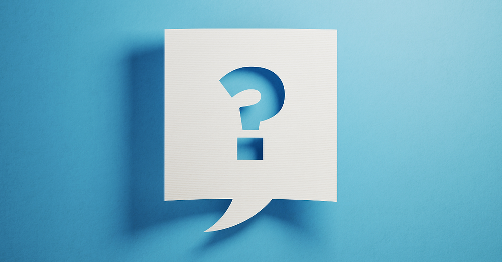 White Chat Bubble On Blue Background With Question Mark On Chat Bubble