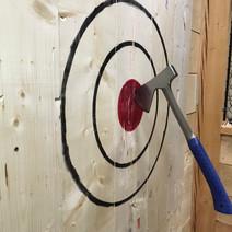 Axe hits bullseye target in Burlington's axe throwing facility