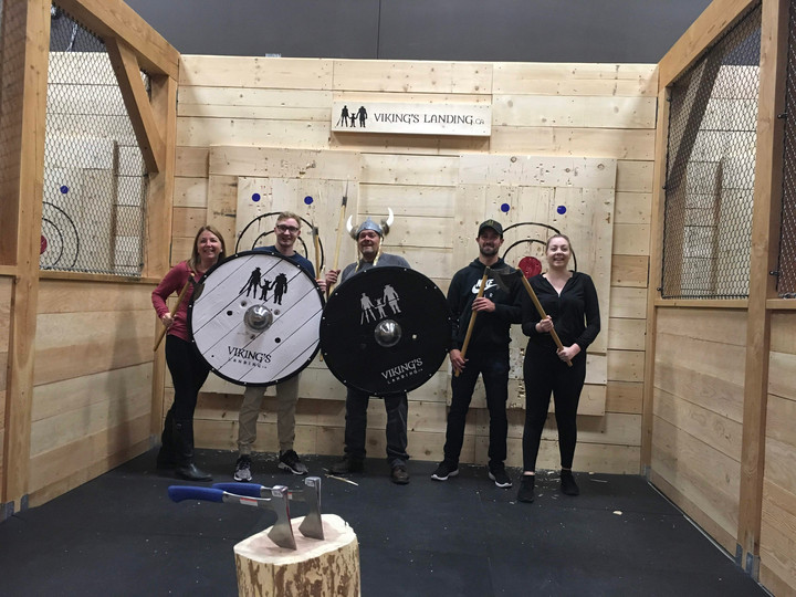 Friends pose with Viking's Landing axe throwing props