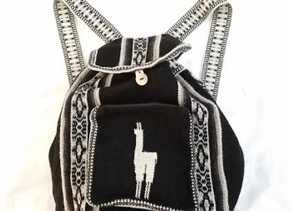 black and white llama backpack