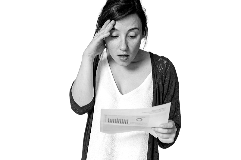 shocked woman looking at a bill for her home renovation