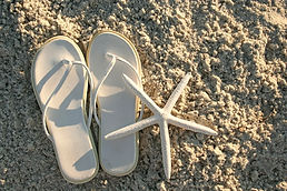 NCBRentals Sandals on the beach