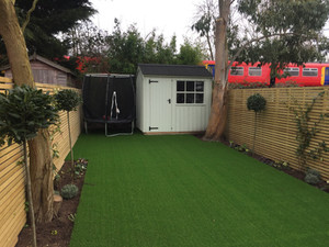 Garden ready for summer!#Artificial grass, #Cladding, #Bay trees