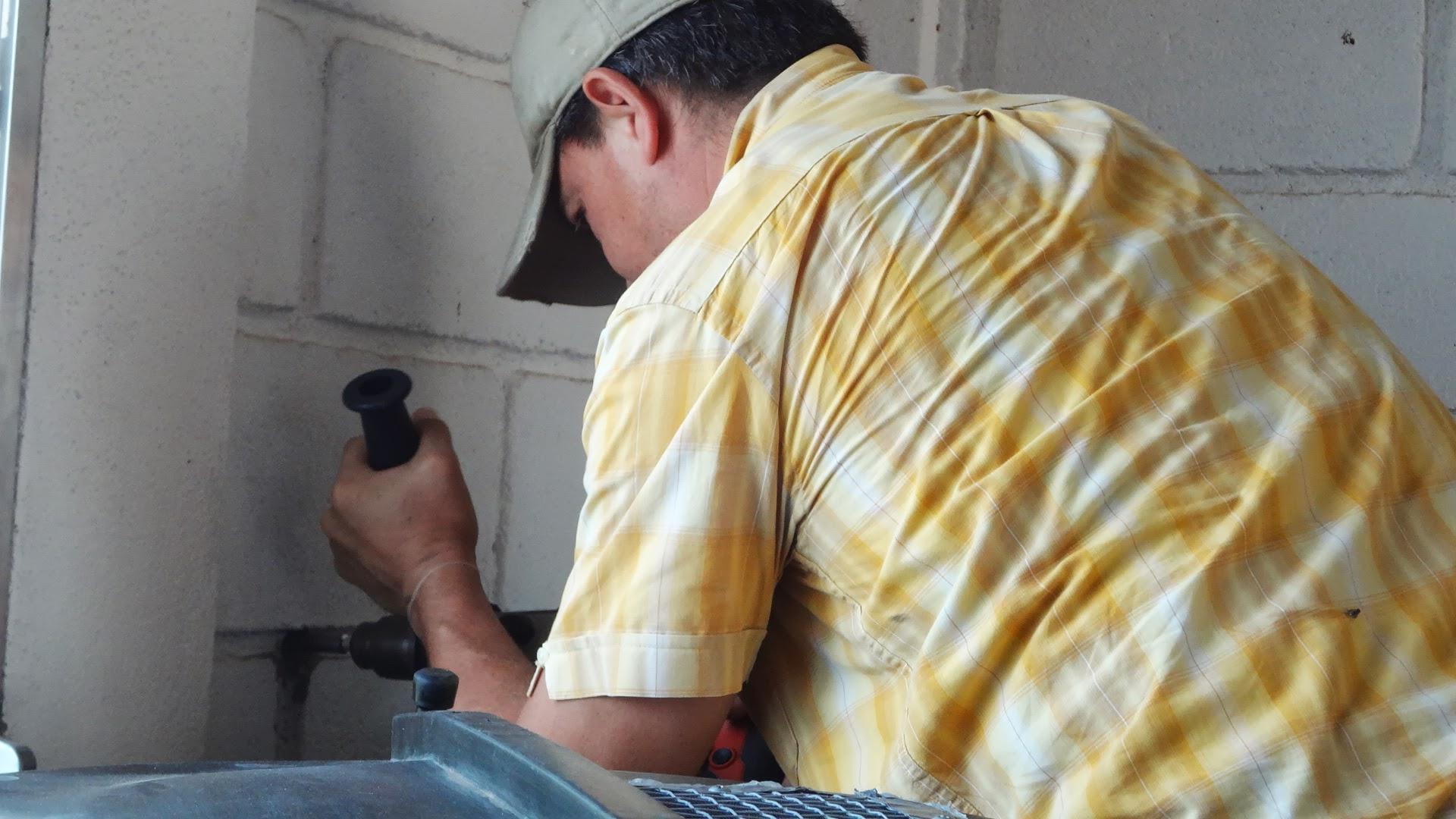 Raph drills into school wall