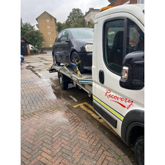 Car being transported by London Recovery Ltd