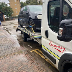 Car being towed in Islington