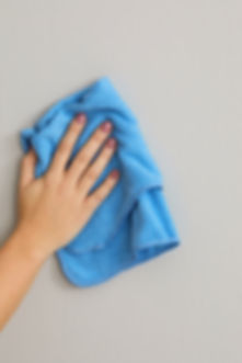 cleaning-wall-with-blue-cloth-b15bfc69.j