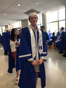 graduate with ribbon