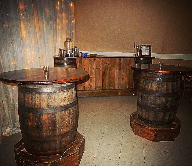Whiskey barrel barn wood bar with co2 keg tap and matching pub tables