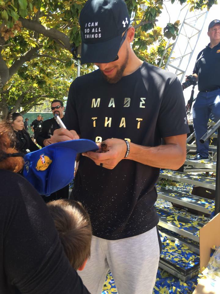 Steph Curry signs for the kids