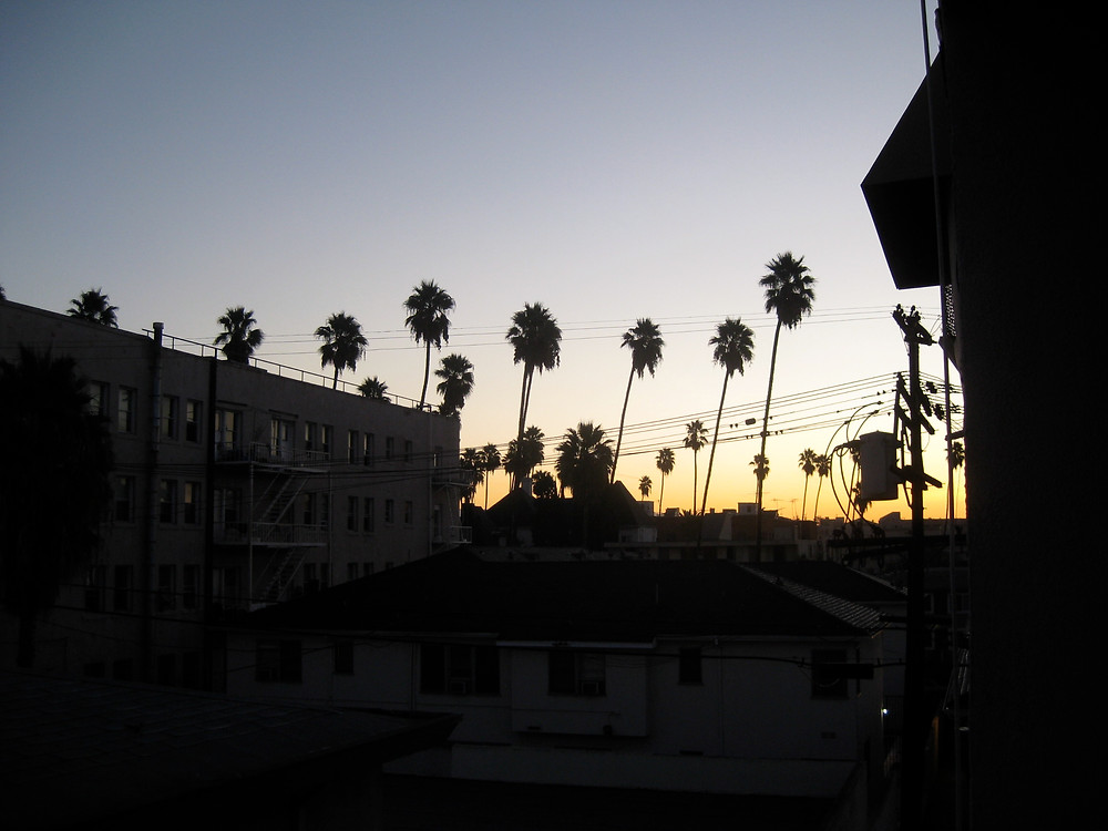 The sun setting over a street in Los Angeles