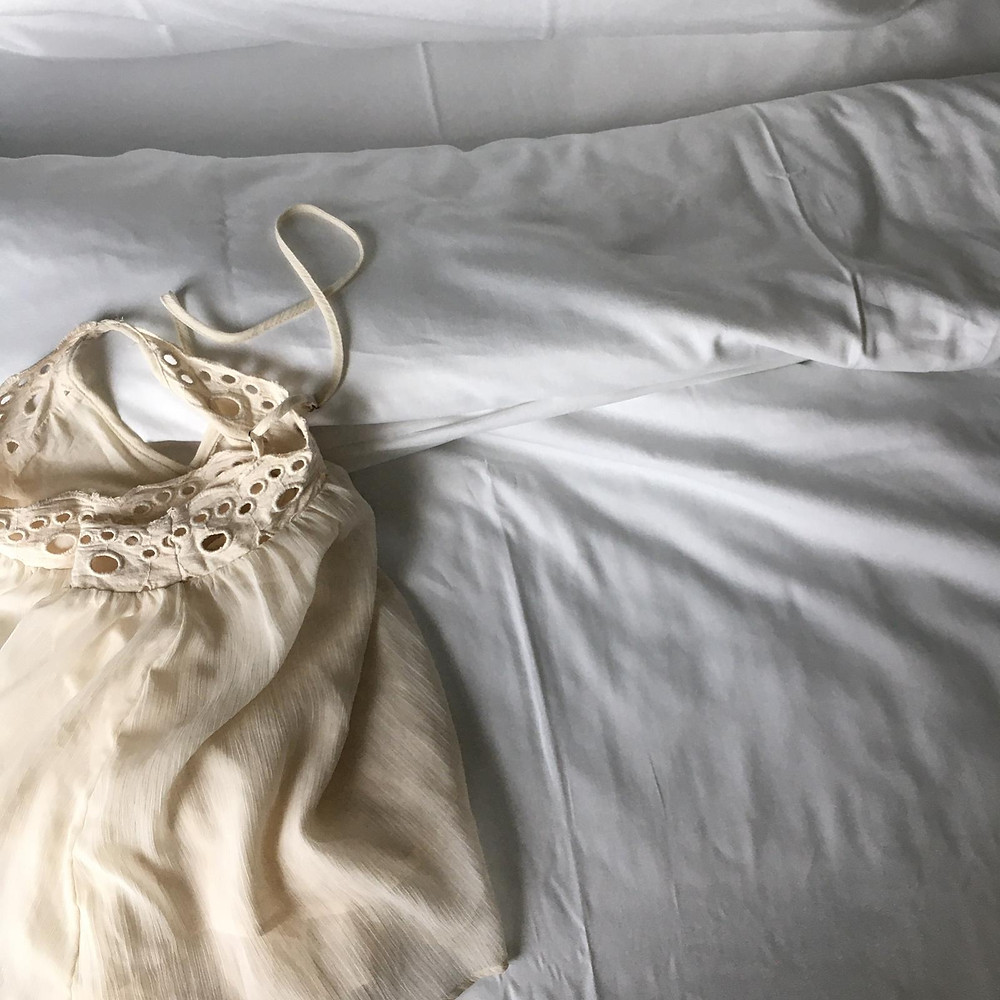 A dressing gown lying on a bed