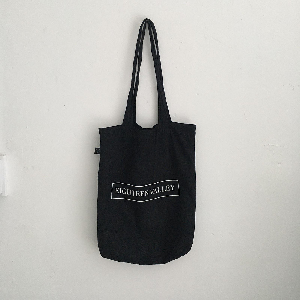 A tote bag by Eighteen Valley hanging on the wall