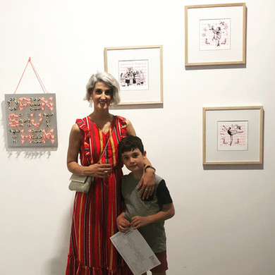 Leah at art exhibition with son