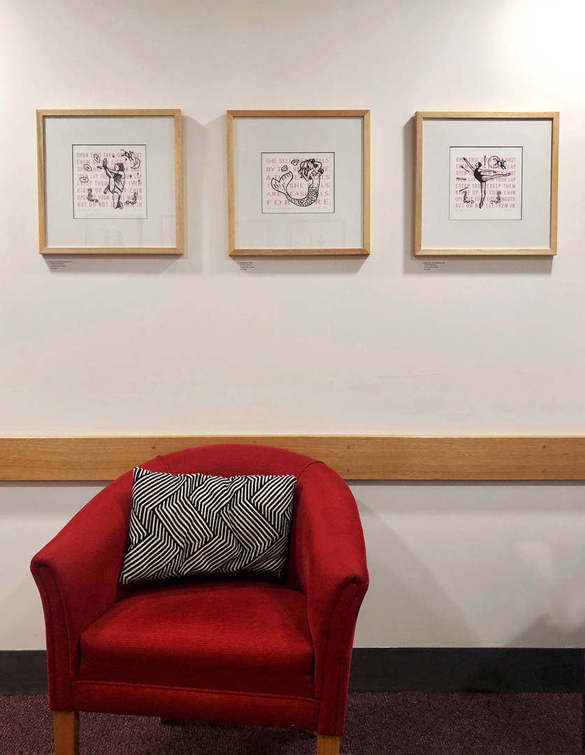 Framed prints in exhibition