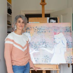 Artist with in progress in artist studio