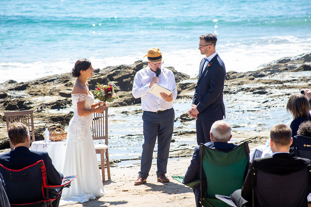 A beautiful long lens capture taken on the foreshore of Lorne Beach as Jess and Matthew exchange their vows ... taken from a considerable distance away and using a 300mm lense.
