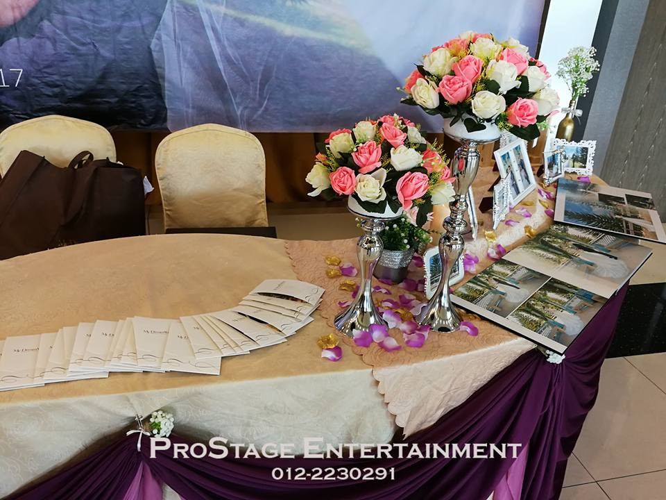 Reception table closeup with flower bouquet stand decoration
