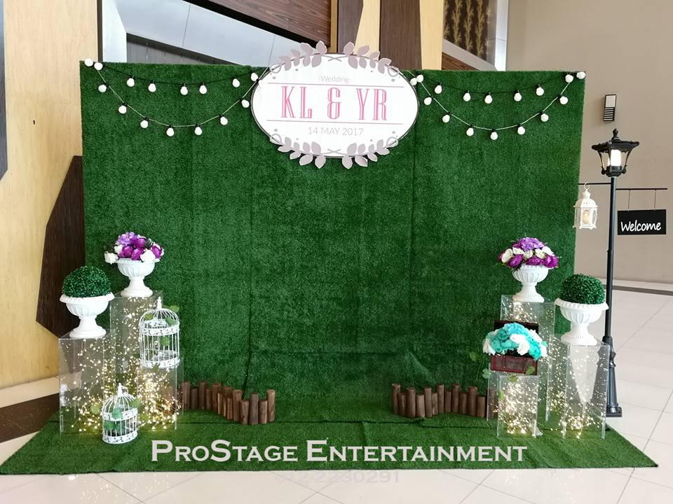 Garden Themed Backdrop with mini flower bouquets, D.I.Y mini logs and lamp post