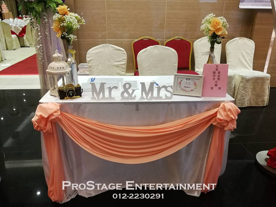 Reception Table with mini antique lamp, camera and D.I.Y flower jars