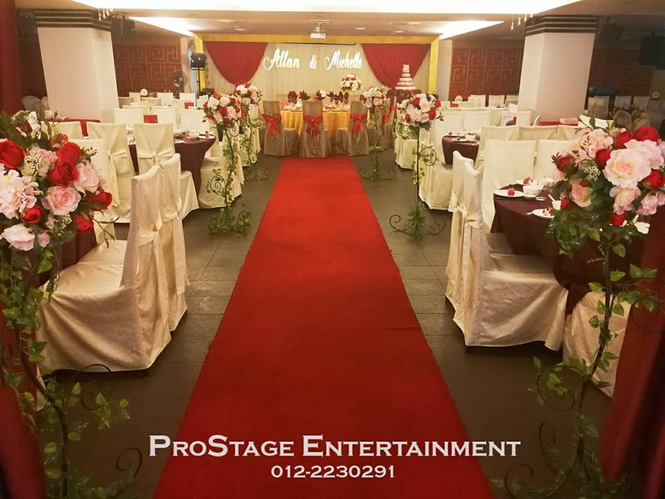 Entrance to wedding dinner place with flower stands